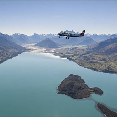 Flying over the striking Lake Wakatipu before crossing the Southern Alps on the way to Milford Sound.