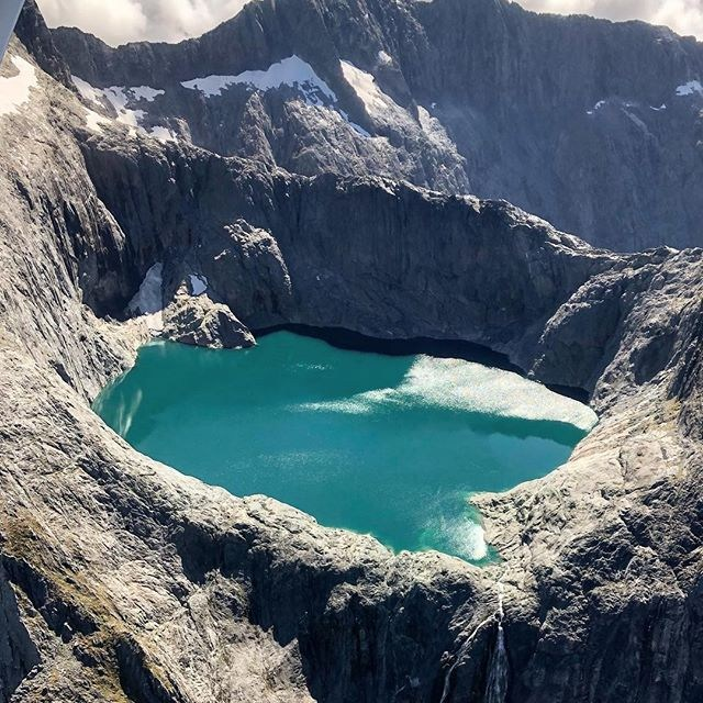 This incredible alpine lake sits at around 4865ft near Terror Peak in the Fiordland National Park 😍🛩️. . 📸@Karllecouteur . . . . #milfordsoundscenicflights #newzealandguide #destinationnz #ig_newzealand #travelnz #nzmustdo #nz #newzealand #southisland #newzealandfinds #newzealandvacations #purenz #purenewzealand #kiwipics #kiwi_photos #realmiddlearth #lifeofnewzealand #wonderlustnewzealand #wanderlustofnz #bestnewzealand #goNZ #earthpixnz #gottalovenz #newzealandnatural #milfordsound #fiordland #lovefiordland #alpinelake #terrorpeak #laketerror