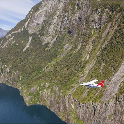 Dwarfed by nature... Our plane making its way in through the fiord to land at Milford Sound Airport.