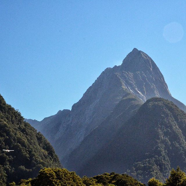 Can you spot our plane taking off from Milford Sound Airport? Looks tiny next to the 5,551 ft Mitre Peak in the background.